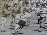 Murwillumbah Brothers' captain-coach, Milton Whybrow (second from left), watches the progress of teammate, Jack Nardi in the play-off for fifth spot in the 1974 Group 18-Gold Coast finals series at Murwillumbah Oval. Prop, Paul 'Porky' Weaver is on Whybrow's left. Surfers Paradise captain-coach, John Chisholm (left knee strapped) sizes up Nardi. The Pirates won, but Tweed Heads Seagulls would go on to beat Mullumbimby in the grand final.